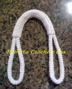 Crochet Purse Handles....step-by-step visual. ☀Chain required length, sc approximately 4-6 rows. Fold in half lenghtwise and sew together to make 'hose'. Crochet rectangle and sew around centre to cover the opening of 'hose'. Now sc two ovals, fold in half over loop ends, sew.