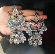 When it comes to accessories nothing can undo the magic of oxidized silver jewelry. Try to switch your style in them often because they are evolving frequently currently this hand painted oxidized one's are trending everywhere. Indian Jewelry Earrings, Indian Jewelry Sets, Silver Jewellery Indian, Jewelry Design Earrings, Ear Jewelry, Bridal Jewelry Sets, Silver Necklaces, Silver Earrings, Silver Jhumkas