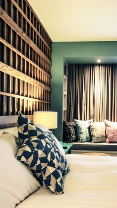 This Modern Irish hotel is set next to the Atlantic Ocean; the interior design combines modern with rustic traditional decor ideas.  While the architecture of the reception is rustic with details found in a country cottage or farmhouse. The natural seaside setting inspires the bedrooms and suites colors.    | #desk | #bed| #headboard |