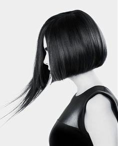 A medium black straight bob asymmetrical hairstyle by Trevor Sorbie