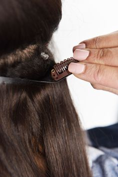 Step 10: Secure the weft clip on top of the elastic and snap closed.   This Guide Will Show You Exactly How To Use Clip-In Hair Extensions