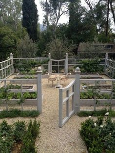 Vegetable garden with gravel around the boxes.