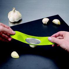 Joseph Joseph® Rocker Garlic Crusher Green - From Lakeland    Need this in my life!