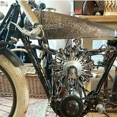 Small radial engine on a bicycle or early motorcycle...