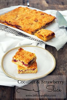 Coconut & Strawberry Jam Slice.  Easy to make from pantry staples and will fill the house with the smell of toasted coconut  | www.bellyrumbles.com