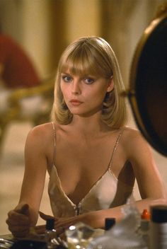 Michelle Pfeiffer in Scarface -- next years Halloween costume?! Guess I'll be needing a  blonde wig!