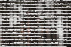 metal grid covered with snow in winter