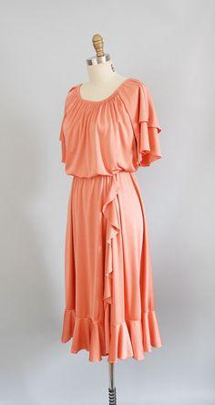 1970s Dress / 70s Melon Disco Dress. $38.00, via Etsy.