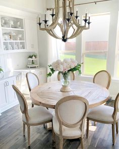 modern farmhouse dining room design, neutral dining room, modern dining room table with dining room chairs and chandelier with white walls and neutral rug Circle Table, Dining Room Design, Round Dinning Room Table, Round Kitchen Tables, Farmhouse Round Dining Table, Eat In Kitchen Table, Round Pedestal Dining Table, Round Table And Chairs, French Country Dining Room
