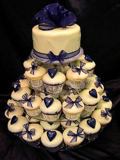 navy blue wedding cake with cupcakes three tier topsy turvy wedding cake with navy blue 17781