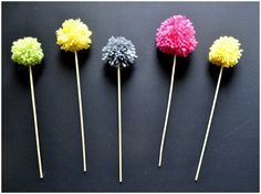 Arty's Getaway: DIY Woolen Pom Poms - Simple and Super Easy Way to bring some Colors to a Room's Corner, use them as Little Fun Décor-Details to a Party Table, Accessorize a Gift, and so on.