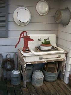 Outdoor sink with hand pump.  This would be cool to make into an outdoor fountain!