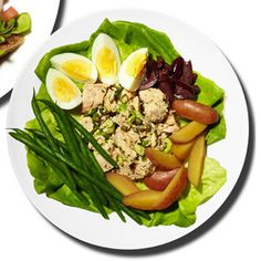 Mix 4 ounces canned albacore tuna, rinsed and drained, with 1 teaspoon capers, 1 teaspoon olive oil, 1 teaspoon chopped fresh flat-leaf parsley, 1 teaspoon chopped scallions, and 1 teaspoon lemon juice. Top 1 cup Boston lettuce with tuna and 1 hard-boiled egg, quartered; 1/2 cup cooked fingerling potatoes; 1/2 cup green beans; and 2 tablespoons quartered Kalamata olives.