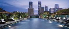Outdoor swimming pool and restaurant mingle with the skyline at Ritz Carlton Shenzen, China