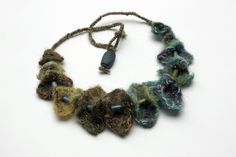 Handmade needle felted necklace with wooden beads. $93.00, via Etsy.