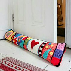 Crochet Graffiti Door Pillow (draft catcher) pattern published in Hip Crochet: 25 Gorgeous Projects for the Home by Natalie Clegg Inspired by street art, this lively door pillow keeps the cold at bay while giving your home a cheerful splash of colour. Crochet Diy, Crochet Home Decor, Love Crochet, Crochet Granny, Crochet Flowers, Crochet Cushions, Crochet Pillow, Pillow Inspiration, Creation Couture