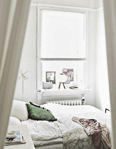 Tiny white bedroom