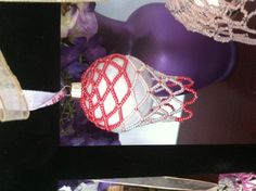 Red and white netted design beaded ornament cover