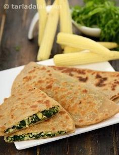 These parathas has a high nutritional value as whole wheat flour and baby corn are both good sources of energy and proteins. In addition, spinach adds to the wealth of their iron, folic acid and vitamin a content. These nutritious parathas are ideal to be packed in your kid's lunch box. They can also be served at parties with spicy pickles like garlic pickle or with a sweet and spicy vegetable pickle.