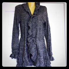NWT cardigan frilly sweater - beautiful!!! Here is a beautiful cardigan new with tags. It's a grey marbled by Carolyn Taylor. Has frilly sleeves and all along edges. So cute!!!size says small but this fits bigger! More like a medium Sweaters Cardigans