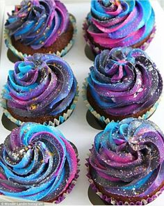 Milky way: Cupcakes have also been made into mini-galaxies using colourful icing...