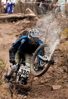 This is a two phase down hill event in which the first half is on a mountain bike and the second half is on a unicycle.