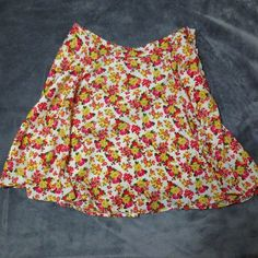 Forever 21 Contemporary Floral Skirt This beautiful skit is great for adding a pop of color to your wardrobe! With bright, springy colors and a light, breezy fabric, it's super comfy and relaxed. It a side zipper and a clasp, the latter of which is coming undone as shown in the third picture. Very feminine and fun! Great for twirling in! A size too big for me. Forever 21 Skirts A-Line or Full