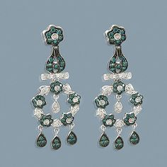 These Blue Diamond Flower Chandelier Earrings weigh approximately 8 grams and showcase ctw of sparkling white and fancy blue diamonds. Featuring an intricate flower design, these ladies diamond chandelier dangle earrings are available in whit Blue Diamond Jewelry, Diamond Flower, Diamond Earrings, Flower Chandelier, Chandelier Earrings, Dangle Earrings, Flower Designs, Bangles, Ice