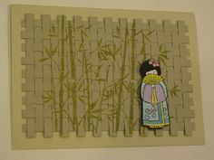 handmade card from Jan's Joy ... woven paper background stamped with bamboo ... small Asian girl with fan ... like it!