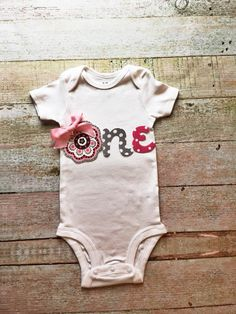 Baby Girl First Birthday Onesie - White with Pink and Grey, Baby Smash Cake Onsie, Baby First Birthday Shirt, Baby Birthday Outfit by Simpletreeboutique on Etsy https://www.etsy.com/listing/249895017/baby-girl-first-birthday-onesie-white