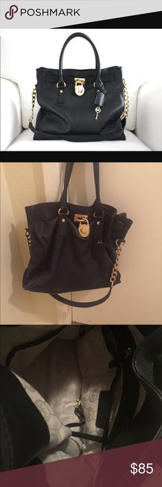 Michael kors black purse Very loved black purse . No longer stiff but still in good condition Michael Kors Bags Shoulder Bags