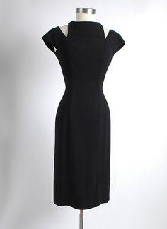 1950's Vintage Luis Estevez Black Crepe Curve Hugging Cocktail Dress, Cut Out. $235.00, via Etsy.