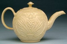 """This teapot is made from a type of earthenware called creamware. Creamware was perfected and marketed sucessfully by the Englisj potter and entrepreneur Josiah Wedgwood (1730-1795). Wedgwood described the new product as """"a species of earthenware for the table, quite new in appearance, covered with rich and brilliant glaze, bearing sudden alterations of heat and cold, manufactured with ease and expedition, and consequently cheap."""""""