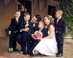 Bride and Groom with their little boys in pink on their wedding day | Lasting Images Photography | villasiena.cc
