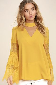 Lulus Exclusive! Pose for a selfie (or the paparazzi!) in your new Step and Repeat Golden Yellow Lace Long Sleeve Top! Gauzy woven fabric is formed to this breezy blouse with mock neck, V cutout, and long bell sleeves with sheer eyelash lace. Back keyhole with two covered button closures.
