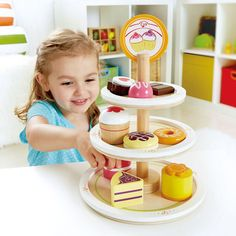 Hape Dessert Tower is a 10 pc play kitchen accessory featuring your favorite desserts. Three tiers will satisfy anyone's sweet tooth. Make a pretend bake shop with your child. Young children love to i