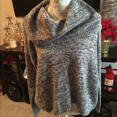 NWT Gray Express Sweater NWT gray Express sweater with oversized turtleneck collar. Size XS/S, super soft, looks cute alone or under vest. Dress casual or dress it up. Cozy and great for winter season. Gray sweater for sale only. Last pic shows what it looks like on. I'm 5'4 and wear a small typically. #nwt #express #sweater #gray #oversized #cozy #soft #top ❌no trades❌ Express Sweaters Cowl & Turtlenecks
