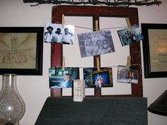 An old window frame for hanging pictures.  [The stitcheries on the sides are going somewhere else - don't like them there!]