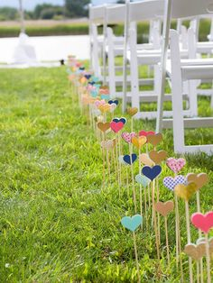 DIY wedding ceremony aisle decor with cut-out hearts