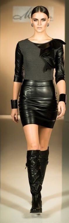 Black leather skirt, multimedia leather top, leather cuffs, black knee boots runway fashion