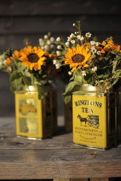 Tea tins to hold flowers. Love this, especially since I'm planning to use tea as a favour.