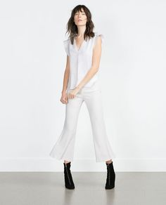 FRILLED SLEEVE TOP ... I love the all white with black boots
