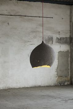 grey pendant light with red cord