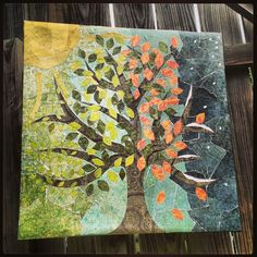 Repurpose an old canvas with mod podge and scrapbook paper.