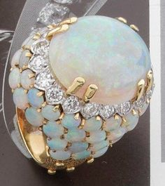 A Gold Cabochon Opal and Diamonds Ring.