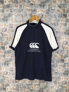 Excited to share this item from my #etsy shop: All Blacks Canterbury Of New Zealand Rugby Shirt Mens Large Steinlager Canterbury All Blacks Shirt CCC #rugbypoloshirt #ralphlaurenrugby #newzealandrugby #menrugbypoloshirt #jonahlomuhaka #cccrugbysports #canterburyshirt #canterburyrugby #benettonrugbyshirt Canterbury New Zealand, All Blacks Shirt, Michael Jordan Shirts, Jordan Jackets, New Zealand Rugby, Preppy Men, Rock T Shirts, Shirt Shop