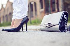 Classic heels, chic purse.