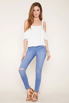 A pair of skinny jeans with a low rise, distressed knees, a zip fly, and a five-pocket construction. #f21denim