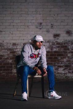 Chris Brown wearing  KNYEW Faded Strapback, Billionaire Boys Club Fox Sweatshirt, Nike Air Max 1 Ultra Essential Sneaker