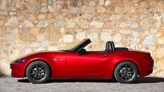 Motor Trend drives the Japanese-spec 2016 Mazda Miata roadster - is it as good as its predecessors? See more than 100 2016 Miata photos right here. Rx7, Mazda Miata, Mazda Mx 5 2016, Top 10 Sports Cars, Mazda Roadster, First Drive, Hot Cars, Car Accessories, Dream Cars
